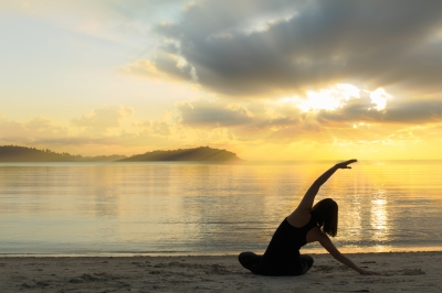 Beautiful Yoga Girl At Sunrise On The Beach by samuiblue on freedigitalphotos.net