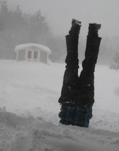 Snow headstand