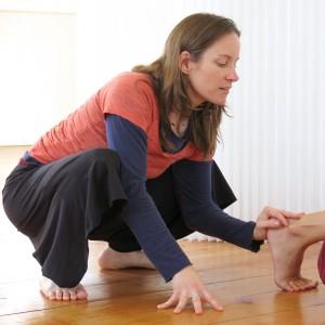 Shannon Assisting a Yoga Pose, Tone Studio, Owen Sound